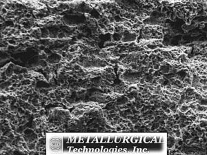 "Higher magnification SEM image of the ""B"" side axial fracture surface in the pre-crack region near the cylinder ID reveals a corroded surface that may be obscuring the original crack morphology. (SEM Photo, Mag. 1,000X)"
