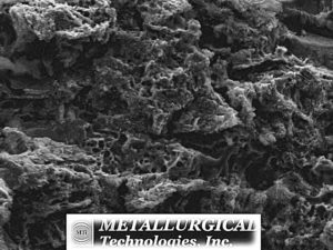 "High magnification SEM image of the ""A"" side opened crack surface near the ID reveals a corroded surface. (SEM Photo, Mag. 2,000X)"